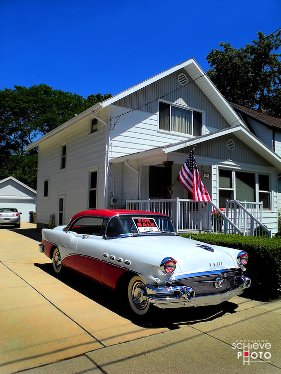 A beautifully restored 1950s era Buick for sale.