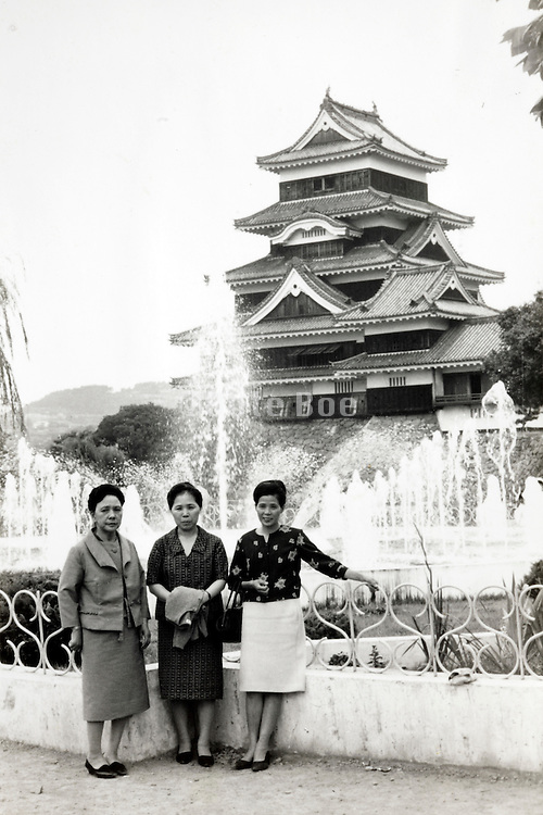 posing in front of Kumamoto castle Japan 1960s