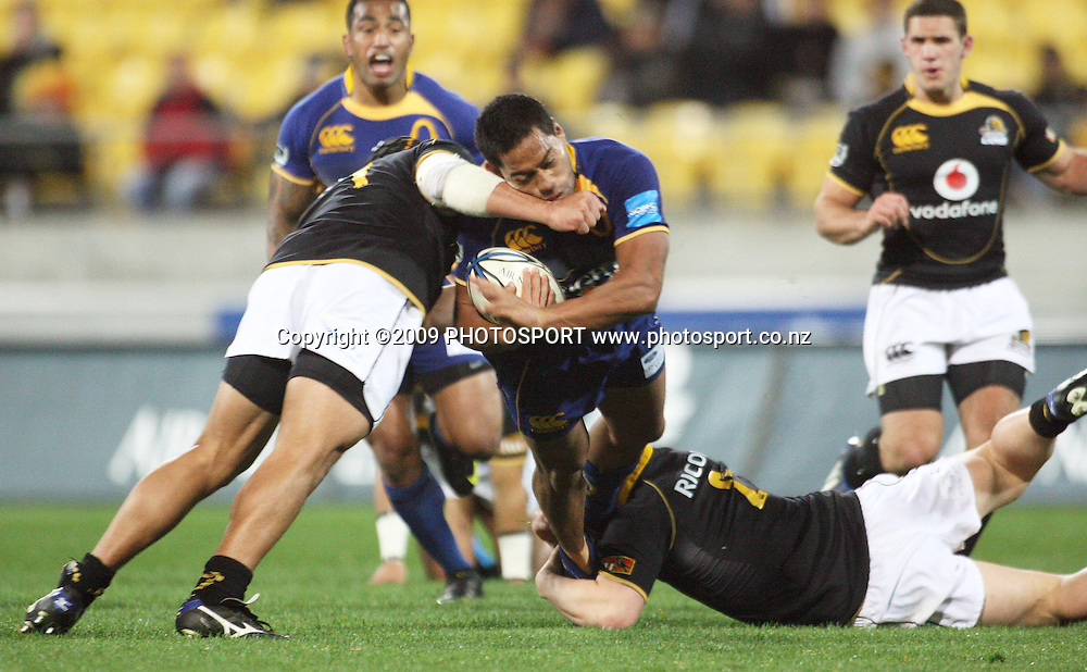 Wellington captain Jacob Ellison (left) tackles Otago captain Alando Soakai.<br /> Air NZ Cup Ranfurly Shield match - Wellington Lions v Otago at Westpac Stadium, Wellington, New Zealand. Friday, 31 July 2009. Photo: Dave Lintott/PHOTOSPORT