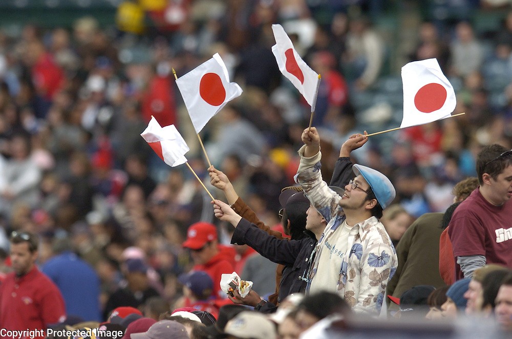 Team Japan fans wave flags during the game against Team USA in Round 2 action at Angel Stadium of Anaheim.