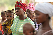 Jenneh Johnson, 31, a mother of six, waits to receive money from a UNICEF-sponsored social cash transfer programme in the village of Julijuah, Bomi county, Liberia on Tuesday April 3, 2012. Beneficiary households receive monthly transfers that vary according to the size of the household, with additional sums provided for each child enrolled in school. Families are selected for participation in the programme based on two key criteria: they must be both extremely poor and labour-constrained.