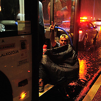 Syrian refugee giving a victory sign in the pouring rain as he sits wrapped up on the steps of the first bus waiting for the final signal just before 4.00a.m. local time, to advance to the Hungarian border post a hundred metres ahead. A standoff lasting weeks and blocking thousands of refugees, most of them Syrian, at Budapest's main railway station has ended dramatically.  More than 1,000 refugees began a march on foot to Vienna because the Hungarian government wouldn't let them take trains to Austria and Germany.  Faced with this, the Hungarian government suddenly reversed its policy. Overnight on September 5 a fleet of buses took 4,000 refugees to the border with Austria.