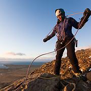 """Freyr Ingi Björnsson at the top of the iceclimb """"Nálaraugað"""" WI4, Búahamrar, Esja."""