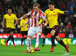 Moritz Bauer of Stoke City battles with Daniel Bachmann of Watford  - Mandatory by-line: Nizaam Jones/JMP - 31/01/2018 - FOOTBALL - Bet365 Stadium - Stoke-on-Trent, England - Stoke City v Watford - Premier League