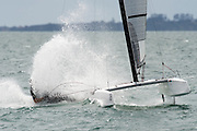 Emirates Team New Zealand sailor Blair Tuke (NZL265) rounding the top mark in race five of the A Class World championships regatta being sailed at Takapuna in Auckland. 13/2/2014