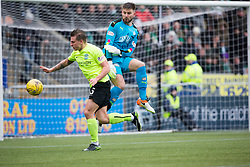 Falkirk's keeper Danny Rogers and Hibernian's Jason Cummings. Falkirk 1 v 2 Hibernian, Scottish Championship game played 31/12/2016 at The Falkirk Stadium .