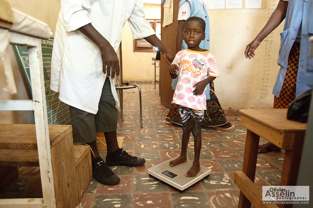 Kambou Sansan, 4, a malnourished boy, stands on a scale during a visit at the Panzarani health center in the village of Panzarani, Zanzan region, Cote d'Ivoire on Friday November 25, 2011.