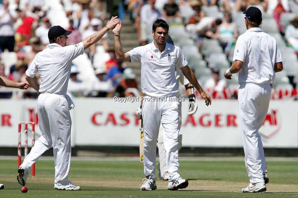 Jimmy Anderson and England celebrate the wicket of Friedel de Wet to end South Africa's fist innings during the 2nd day of the third test match between South Africa and England held at Newlands Cricket Ground in Cape Town on the 4th January 2010.Photo by: Ron Gaunt/ SPORTZPICS