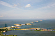 Nederland, Noord-Holland, Den Oever, 14-07-2008; Afsluitdijk, waterkering tussen Waddenzee en IJsselmeer (rechts, voorheen Zuiderzee); aanleg van de dijk vormde onderdeel Zuiderzeewerken, initiatief van ingenieur Cornelis Lely; in de dijk de Stevinsluizen, spuisluizen - uitwaterende sluizen; het 'eiland' heet Robbenplaat; onder in beeld de schutsluizen  en Zuiderhaven; schutsluis.The IJsselmeer Dam, dike between the provinces Noord-Holland and Friesland, left Wadden sea, right former Zuyder Zee (now inner sea/lake);in the foreground locks for shipping and sluicing surplus water. .luchtfoto (toeslag); aerial photo (additional fee required); .foto Siebe Swart / photo Siebe Swart