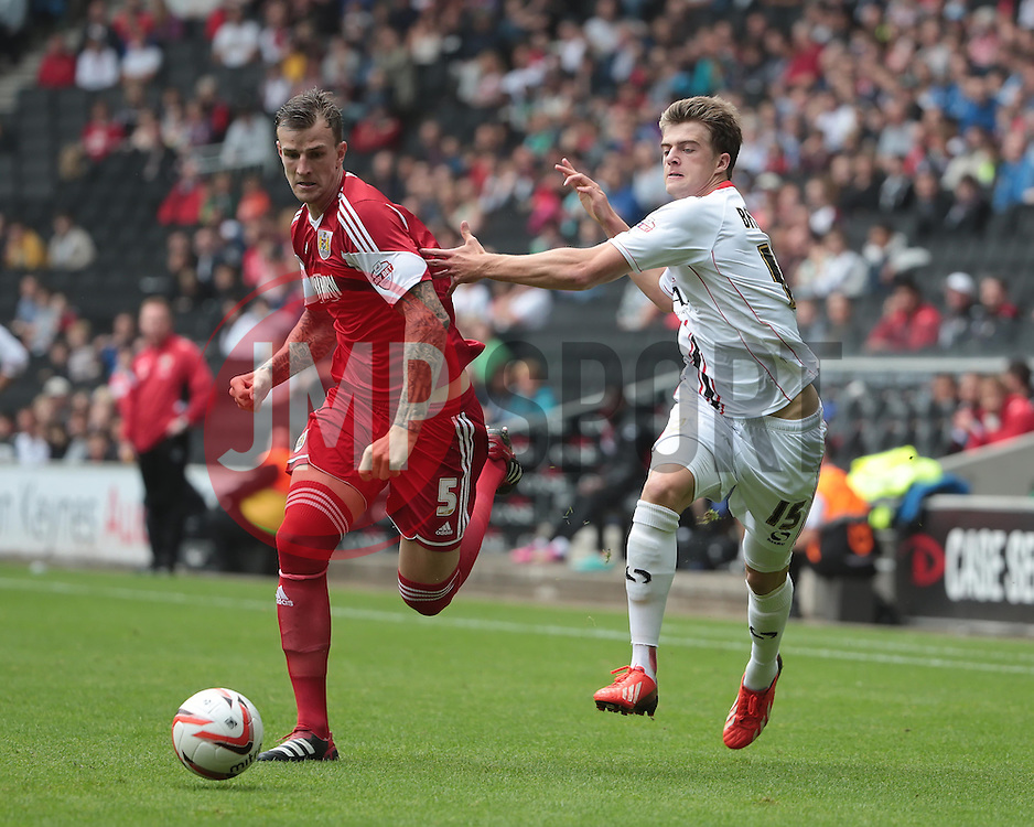 Milton Keynes Dons' Patrick Bamford challenges with Bristol City's Aden Flint   - Photo mandatory by-line: Nigel Pitts-Drake/JMP - Tel: Mobile: 07966 386802 24/08/2013 - SPORT - FOOTBALL - Stadium MK - Milton Keynes - Milton Keynes Dons V Bristol City - Sky Bet League One