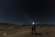 Self portrait in sand dunes at night in Death Valley National Park, California, USA