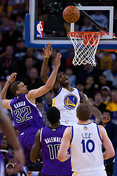 April 10, 2011; Oakland, CA, USA;  Golden State Warriors small forward Dorell Wright (1) shoots past Sacramento Kings shooting guard Francisco Garcia (32) during the first quarter at Oracle Arena. Sacramento defeated Golden State 104-103.