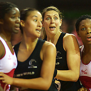 Wide eyed Irene Van Dyk, New Zealand, (second from right)  in action in her 200th test match as she jostles for position with team mate Maria Tutaia and Ama Agbeze, England (left) and Eboni Beckford-Chambers, England, (right) during the New Zealand V England, New World International Netball Series, at the ILT Velodrome, Invercargill, New Zealand. 6th October 2011. Photo Tim Clayton...