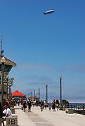 Goodyear Blimp Flying over Huntington Beach Pier