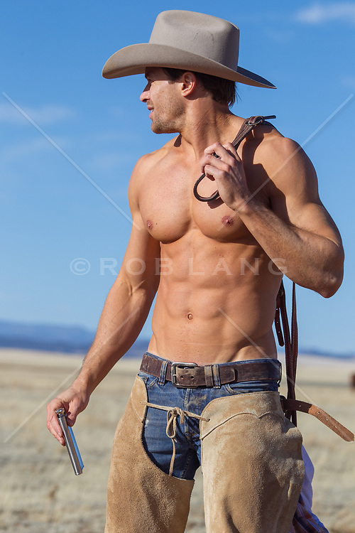 very good looking shirtless muscular cowboy on a ranch