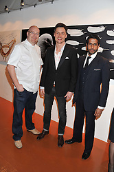 Left to right, SIMON HULSTONE, PASCAL ANSON and PRASANNA PUWANARAJAH at the launch of Flight BA2012 - an evening of Art, Food and Film to see Olympic Games inspires work by rising British Talent held at BA's pop up venue at 3-10 Shoreditch High Street, London E1 on 3rd April 2012.