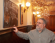 Michael Leifer shows some of the old photographs hanging on the Peanut Bar walls, as he speaks about the state of his restaurant, which is directly across the street from the Reading Eagle, and is set to go on the auction block Wednesday, May 15, 2019 at Jimmie Kramer's The Peanut Bar in Reading, Pennsylvania. WILLIAM THOMAS CAIN / For The Inquirer