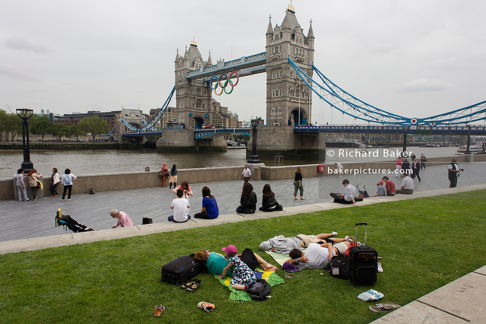 The Olympic rings are suspended from the walkway of London's Tower Bridge, weeks before the Olympiad in July 2012.