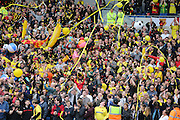 Watford fans celebrate promotion to the Premier League during the Sky Bet Championship match between Brighton and Hove Albion and Watford at the American Express Community Stadium, Brighton and Hove, England on 25 April 2015.