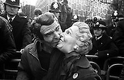 Masked protesters of western leaders Ronald Reagan and Margaret Thatcher kiss at a 1986 demonstration by the Campaign for Nuclear Disarmament (CND) against the hosting by the UK of US nuclear cruise missiles on British soil. Amid a chaotic scene of protest and intimidating police presence, the two unidentified people touch lips outside the US embassy (background) in London's Grosvenor Square. In the Cold War era, both world leaders Reagan and Thatcher symbolised the special relationship between the US and the UK, who shared a common ideology for conquering the threats of Communist domination. Their answer was for the proliferation of atomic arsenals in order to maintain world stability and public protest was ever-present outside US interests and especially at the many RAF air bases that were leased to the US Air Force from where bombers flew.