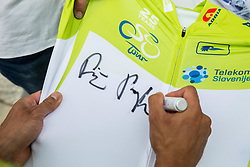 Primoz Roglic of Team Lotto NL Jumbo, Stage winner and winner in Overall classification signing a green jersey after the trophy ceremony after the 5th Time Trial Stage of 25th Tour de Slovenie 2018 cycling race between Trebnje and Novo mesto (25,5 km), on June 17, 2018 in  Slovenia. Photo by Vid Ponikvar / Sportida