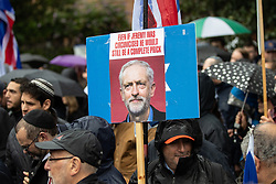 "© Licensed to London News Pictures . 16/09/2018. Manchester, UK. A placard reading "" Even if Jeremy was circumcised he would still be a complete prick "" with a photograph of Labour leader Jeremy Corbyn . Thousands of people including the UK's Chief Rabbi and several Members of Parliament attend a demonstration against rising anti-Semitism in British politics and society , at Cathedral Gardens in Manchester City Centre . Photo credit : Joel Goodman/LNP"