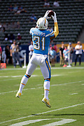 Los Angeles Chargers defensive back Adrian Phillips (31) leaps and catches a pass during pregame warmups before the NFL week 5 regular season football game against the Oakland Raiders on Sunday, Oct. 7, 2018 in Carson, Calif. The Chargers won the game 26-10. (©Paul Anthony Spinelli)