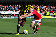 Barnsley defender George Williams and Burton Albion forward Lucas Akins come together during the Sky Bet League 1 match between Burton Albion and Barnsley at the Pirelli Stadium, Burton upon Trent, England on 16 April 2016. Photo by Aaron  Lupton.