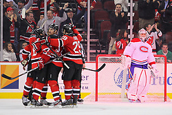 Feb 2; Newark, NJ, USA; The New Jersey Devils celebrate a goal by New Jersey Devils right wing Dainius Zubrus (8) on Montreal Canadiens goalie Carey Price (31) during the third period at the Prudential Center. The Devils defeated the Canadiens 5-3.