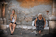In Sicily they say the sun shines brighter, the shadows are darker and life is lived full-on and for the moment. Overloaded with art treasures, wonderful landscapes and magnificent volcanoes, undersupllied with infrastructure and continually struggling to thrawt Mafia-driven corruption, Sicily posseses some baffling social topography. One can wonder the old streets of Taormina or ply the limpid waters in the sparkling coves below. One can bargain with the fish vendors at dawn, climb Europe's ,ost active volcano (Mount Etna) in the afternoon and enjoy Sicily's best nightlife in the constantly buzzing Catania.