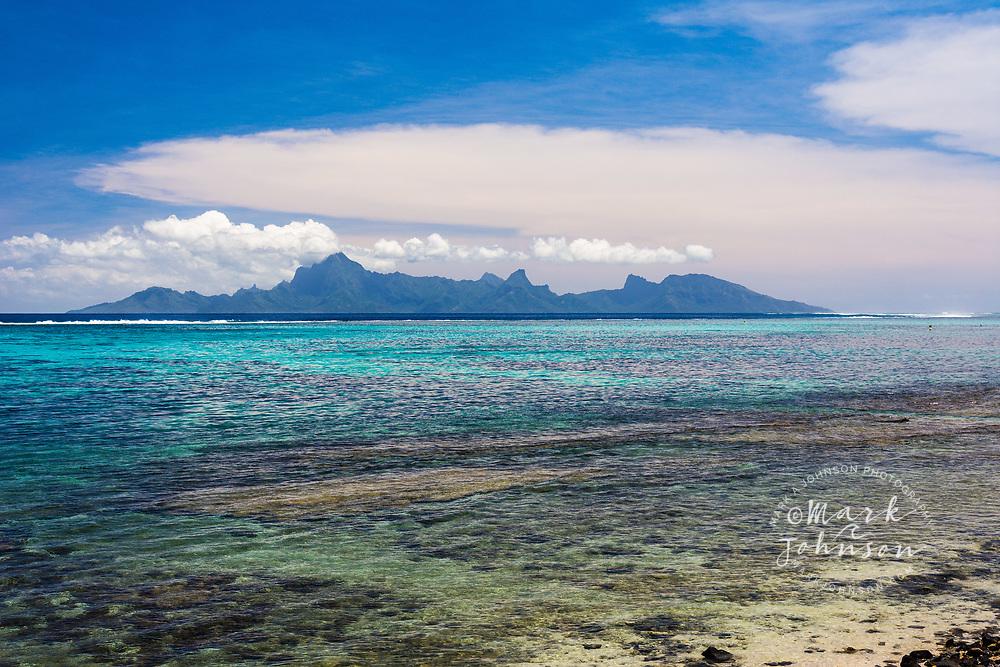 Plage du Mahana, Tahiti, French Polynesia. Moorea island in the distance