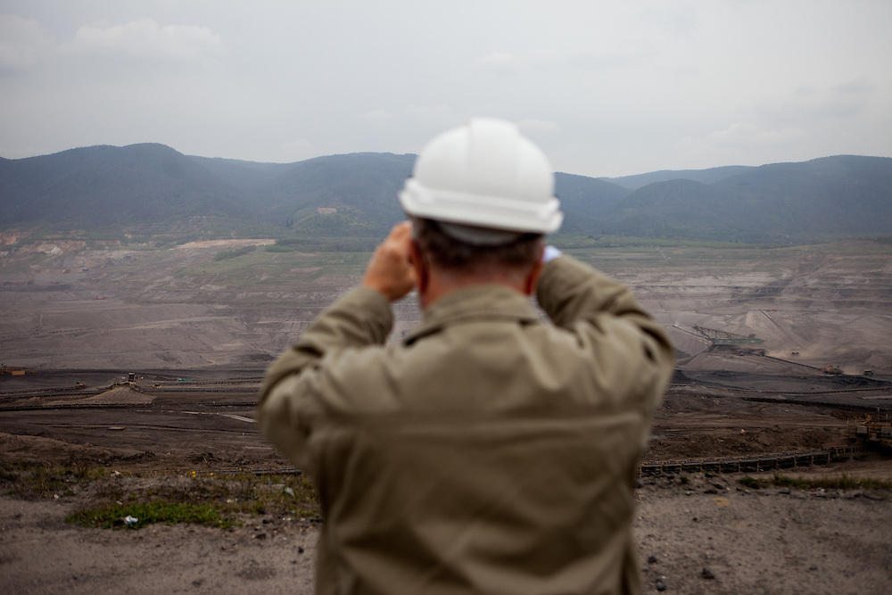 "A visitor is photographing the North Bohemian Brown Coal Basin during a so called ""Czech Coal Safari"" in Most. The Czech Coal Group offers visitors the possibilty to see unique technical works in the mining areas of their surface mines."