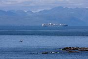 A cargo ship nears Cape Flattery on Neah Bay, Washington.