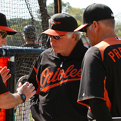March 14, 2011; Sarasota, FL, USA; Baltimore Orioles manager Buck Showalter talks with batting coach Jim Presley and instructor Terry Crowley during batting practice  before a spring training exhibition game at Ed Smith Stadium.   Mandatory Credit: Derick E. Hingle