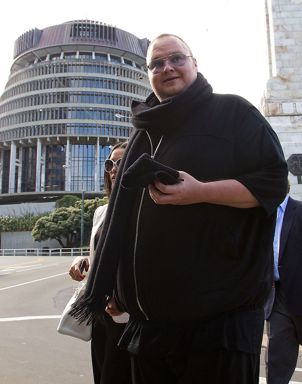 Kim Dotcom with his wife Mona leave Parliament grounds after watching question time at Parliament, Wellington, New Zealand, Wednesday, September 19 2012. Credit: SNPA / Marty Melville