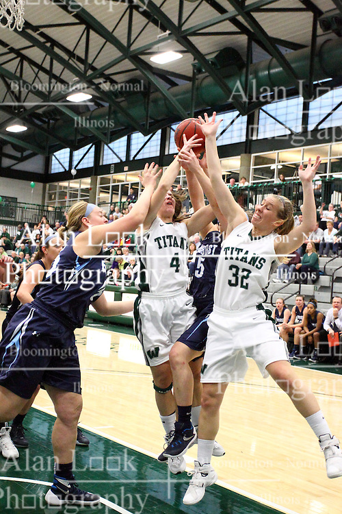 20 February 2016:  Rebekah Ehresman and Samantha Ellsworth during an NCAA women's basketball game between the Elmhurst Bluejays and the Illinois Wesleyan Titans in Shirk Center, Bloomington IL
