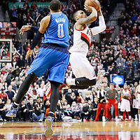 07 December 2013: Portland Trail Blazers point guard Damian Lillard (0) makes a late three point jumpshot to tie the game with 1.9 second remaining over Dallas Mavericks small forward Shawn Marion (0) during the Dallas Mavericks 108-106 victory over the Portland Trail Blazers at the Moda Center, Portland, Oregon, USA.
