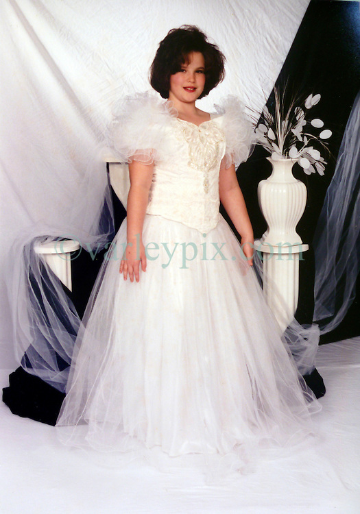 21 May 2015. Laurel, Mississippi.<br /> Collect photos of plus size model Tess Holliday (formerly known as Tess Munster, n&eacute;e Ryann Hoven) in her formative years from a family album. A teenage Tess in white dress. <br /> Photo credit; Tadlock via Varleypix.com