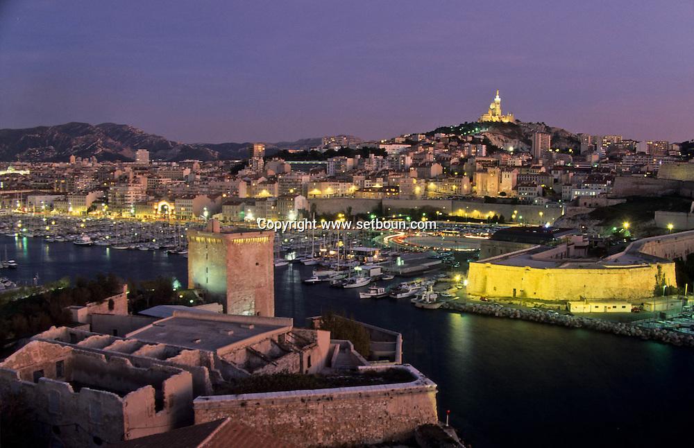 VIEW FROM THE KING RENE TOWER ON FORT SAINT JEAN FORT ENTRACATEAUX NOTRE DAME DE LA GARDE CHURCH AND The port  Marseille  France  ///LE FORT SAINT JEAN;  ENTRECASTEAUX. EGLISE NOTRE DAME DE LA GARDE ET LE PORT. VUE DEPUIS LA TOUR DU ROI RENE SUR   Marseille  France  //    L0008268  /  R20711  /  P115603