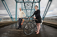 Lifetime member of the Adventure Cycling Association Jenny Park and her boyfriend and touring partner John Sweet stand on the Walnut Street Bridge on February 20, 2017. © Dan Henry / BiciPhoto.com