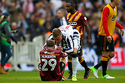 Bradford City defender Anthony McMahon (29) being consoled by Millwall defender Byron Webster (17)  after losing the EFL Sky Bet League 1 play off final match between Bradford City and Millwall at Wembley Stadium, London, England on 20 May 2017. Photo by Simon Davies.