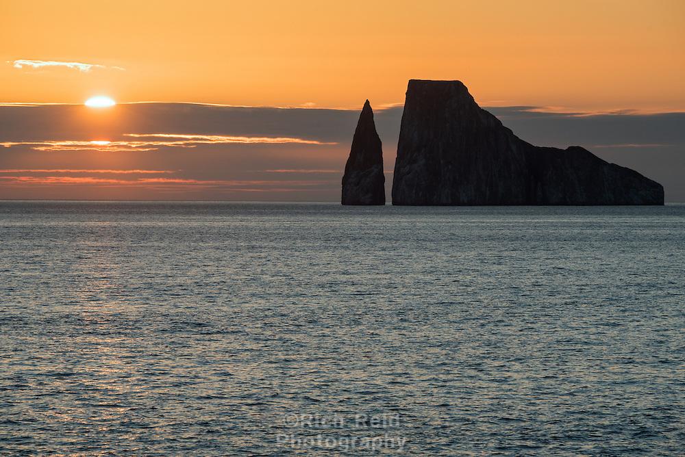 Sun setting near Leon Dormido off of Sab Cristabol Island in the Galapagos, Ecuador.