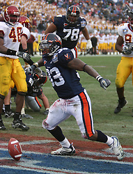 Virginia running back Wali Lundy (33) celebrates after scoring a touchdown.  The Virginia Cavaliers defeated the Minnesota Golden Gophers 34-31 at the Music City Bowl in Nashville, TN on December 30, 2005.