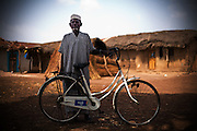 An elderby man poses with his bicycle in Salaga, northern Ghana on Thursday March 26, 2009.