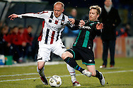Onderwerp/Subject: Willem II - FC Groningen - Eredivisie<br /> Reklame:  <br /> Club/Team/Country: <br /> Seizoen/Season: 2012/2013<br /> FOTO/PHOTO: Danny GUIJT (L) of Willem II in duel with Rasmus LINDGREN (R) of FC Groningen. (Photo by PICS UNITED)<br /> <br /> Trefwoorden/Keywords: <br /> #04 $94 &plusmn;1355238911262<br /> Photo- &amp; Copyrights &copy; PICS UNITED <br /> P.O. Box 7164 - 5605 BE  EINDHOVEN (THE NETHERLANDS) <br /> Phone +31 (0)40 296 28 00 <br /> Fax +31 (0) 40 248 47 43 <br /> http://www.pics-united.com <br /> e-mail : sales@pics-united.com (If you would like to raise any issues regarding any aspects of products / service of PICS UNITED) or <br /> e-mail : sales@pics-united.com   <br /> <br /> ATTENTIE: <br /> Publicatie ook bij aanbieding door derden is slechts toegestaan na verkregen toestemming van Pics United. <br /> VOLLEDIGE NAAMSVERMELDING IS VERPLICHT! (&copy; PICS UNITED/Naam Fotograaf, zie veld 4 van de bestandsinfo 'credits') <br /> ATTENTION:  <br /> &copy; Pics United. Reproduction/publication of this photo by any parties is only permitted after authorisation is sought and obtained from  PICS UNITED- THE NETHERLANDS