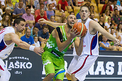 Nebojsa Joksimovic of Slovenia between Rasko Katic of Serbia and Vladimir Stimac of Serbia during friendly match between National teams of Slovenia and Serbia for Eurobasket 2013 on August 3, 2013 in Arena Zlatorog, Celje, Slovenia. Slovenia derated Serbia 67-52. (Photo by Vid Ponikvar / Sportida.com)