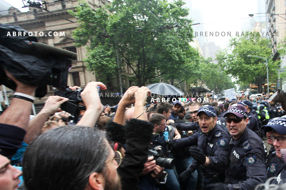 © Licensed to London News Pictures. 21/010/2011. Melbourne, Australia. Victorian police riot squad begin to charge towards protesters in an effort to keep them off the street during occupy Melbourne Protest in Melbourne's central business district. Photo credit : Asanka Brendon Ratnayake/LNP
