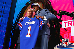 April 26, 2018 - Arlington, TX, U.S. - ARLINGTON, TX - APRIL 26:  Tremaine Edmunds holds up a jersey and takes a photo with NFL Commissioner Roger Goodell after being chosen by the Buffalo Bills with the 16th pick during the first round at the 2018 NFL Draft at AT&T Statium on April 26, 2018 at AT&T Stadium in Arlington Texas.  (Photo by Rich Graessle/Icon Sportswire) (Credit Image: © Rich Graessle/Icon SMI via ZUMA Press)