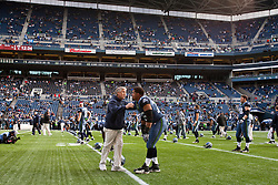 December 5, 2010; Seattle, WA, USA;  Seattle Seahawks head coach Pete Carroll talks with offensive tackle Sean Locklear (75) during warm ups before the game against the Carolina Panthers at Qwest Field. Seattle defeated Carolina 31-14.