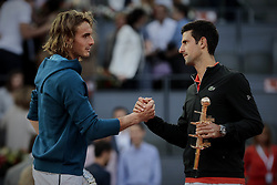 May 12, 2019 - Madrid, Madrid, Spain - Stefanos Tsitsipas from Greece and Novak Djokovic from Serbia are seen shaking hands after the Mutua Madrid Open Masters final match on day eight at Caja Magica in Madrid..Novak Djokovic beats Stefanos Tsitsipas. (Credit Image: © Legan P. Mace/SOPA Images via ZUMA Wire)